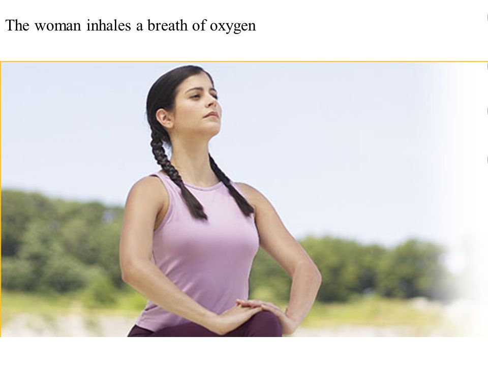 The woman inhales a breath of oxygen