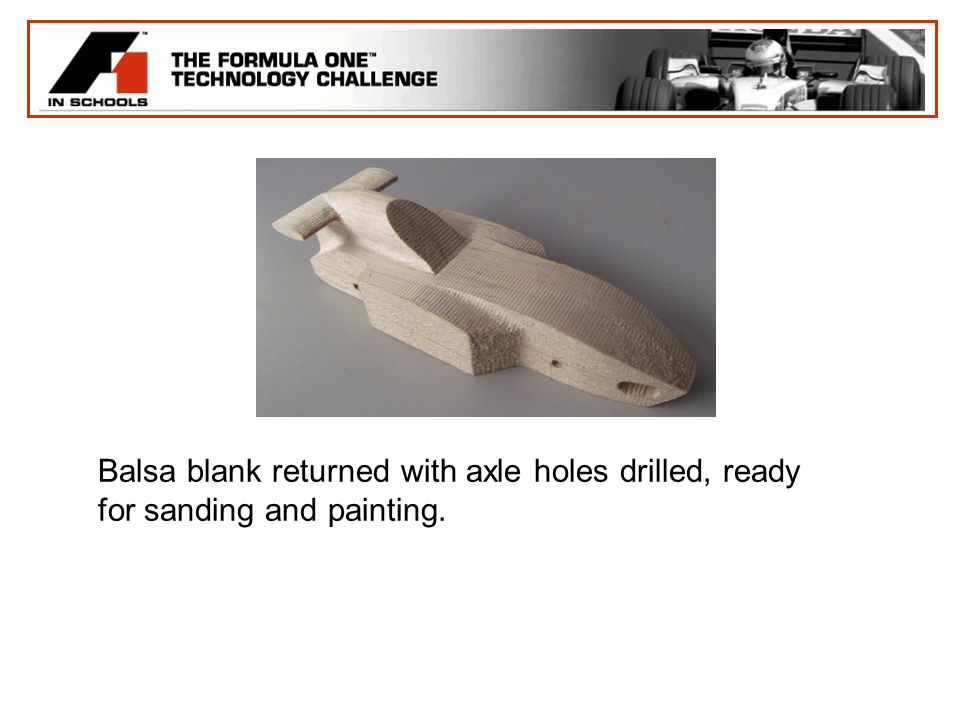 Balsa blank returned with axle holes drilled, ready for sanding and painting.