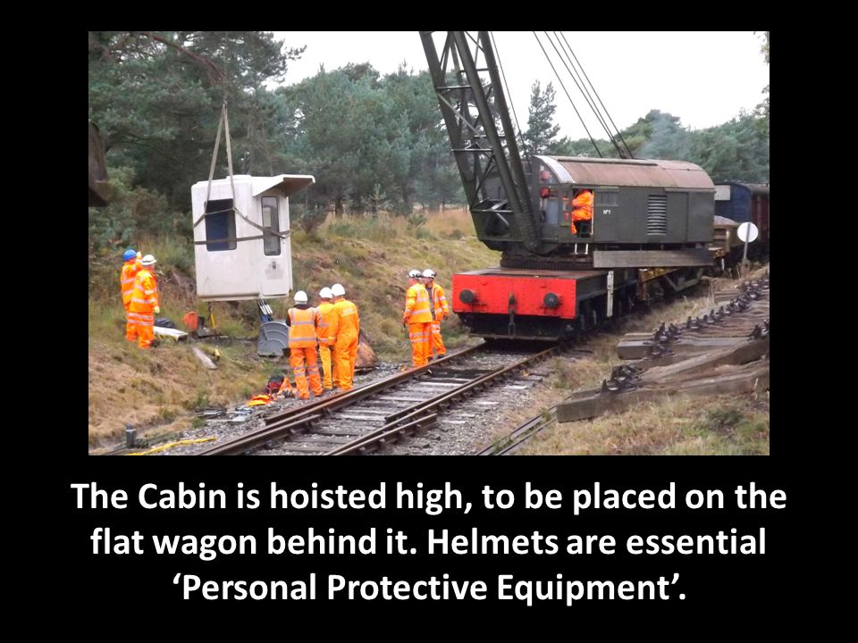 The Cabin is hoisted high, to be placed on the flat wagon behind it.