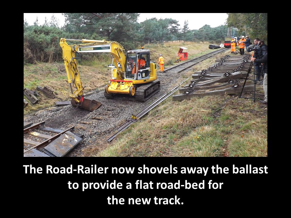 The Road-Railer now shovels away the ballast to provide a flat road-bed for the new track.