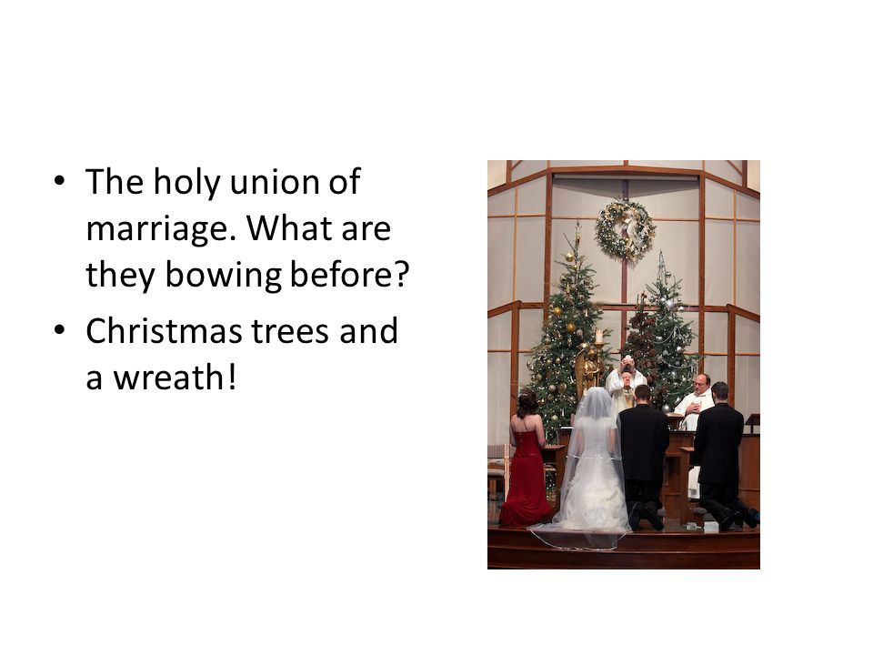 Merry Satanmas The holy union of marriage. What are they bowing before.