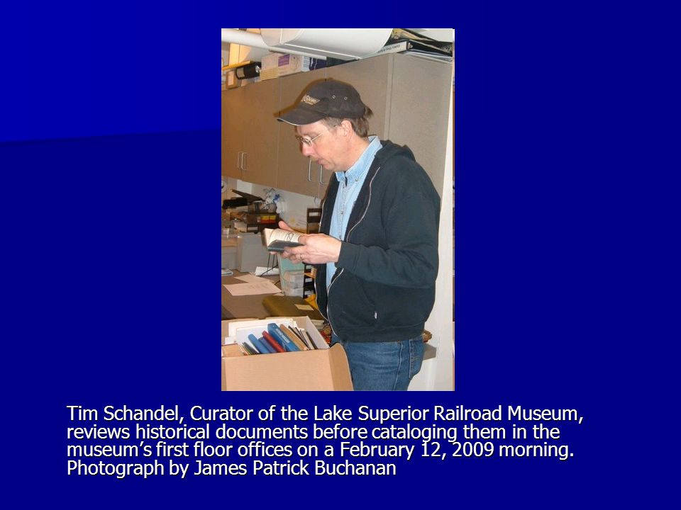 Tim Schandel, Curator of the Lake Superior Railroad Museum, reviews historical documents before cataloging them in the museum's first floor offices on a February 12, 2009 morning.