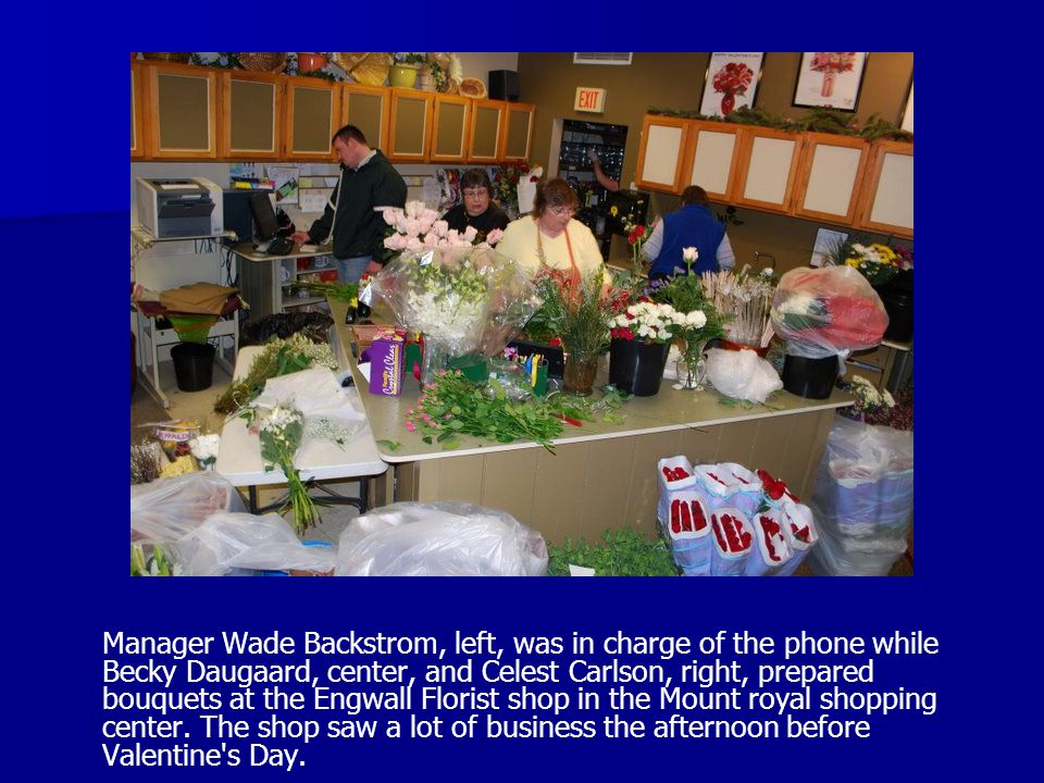 Manager Wade Backstrom, left, was in charge of the phone while Becky Daugaard, center, and Celest Carlson, right, prepared bouquets at the Engwall Flo