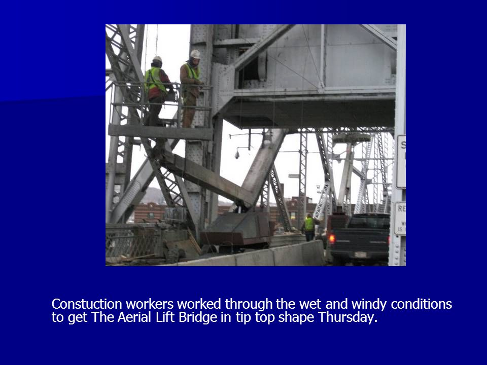 Constuction workers worked through the wet and windy conditions to get The Aerial Lift Bridge in tip top shape Thursday.