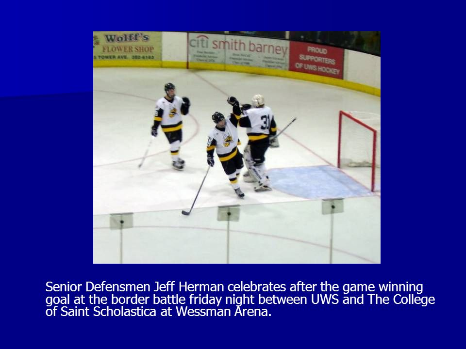 Senior Defensmen Jeff Herman celebrates after the game winning goal at the border battle friday night between UWS and The College of Saint Scholastica at Wessman Arena.