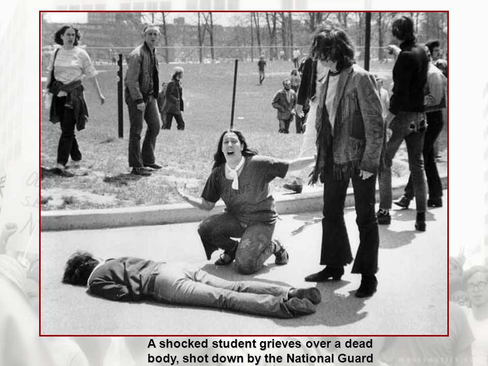 A shocked student grieves over a dead body, shot down by the National Guard