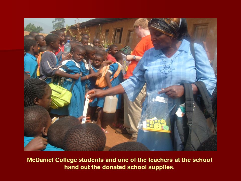 McDaniel College students and one of the teachers at the school hand out the donated school supplies.
