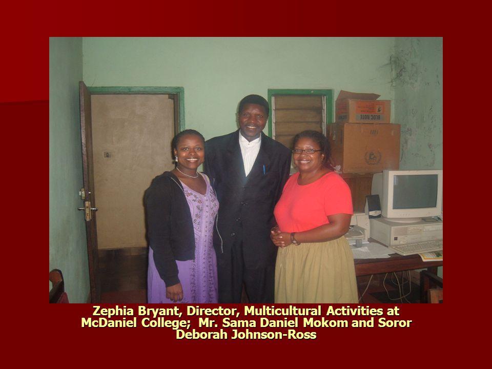 Zephia and Deborah speaking with one of the school's teachers.