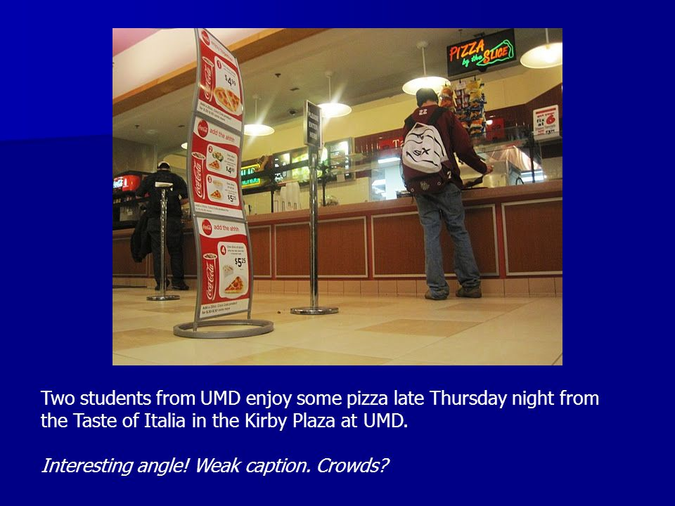 Two students from UMD enjoy some pizza late Thursday night from the Taste of Italia in the Kirby Plaza at UMD. Interesting angle! Weak caption. Crowds
