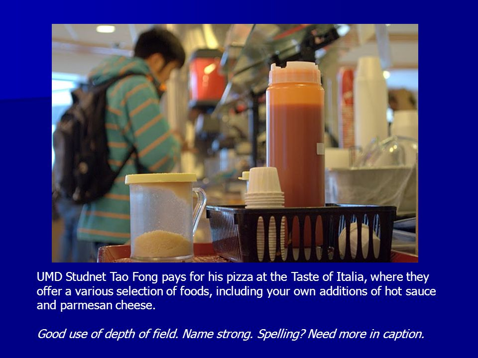 UMD Studnet Tao Fong pays for his pizza at the Taste of Italia, where they offer a various selection of foods, including your own additions of hot sau