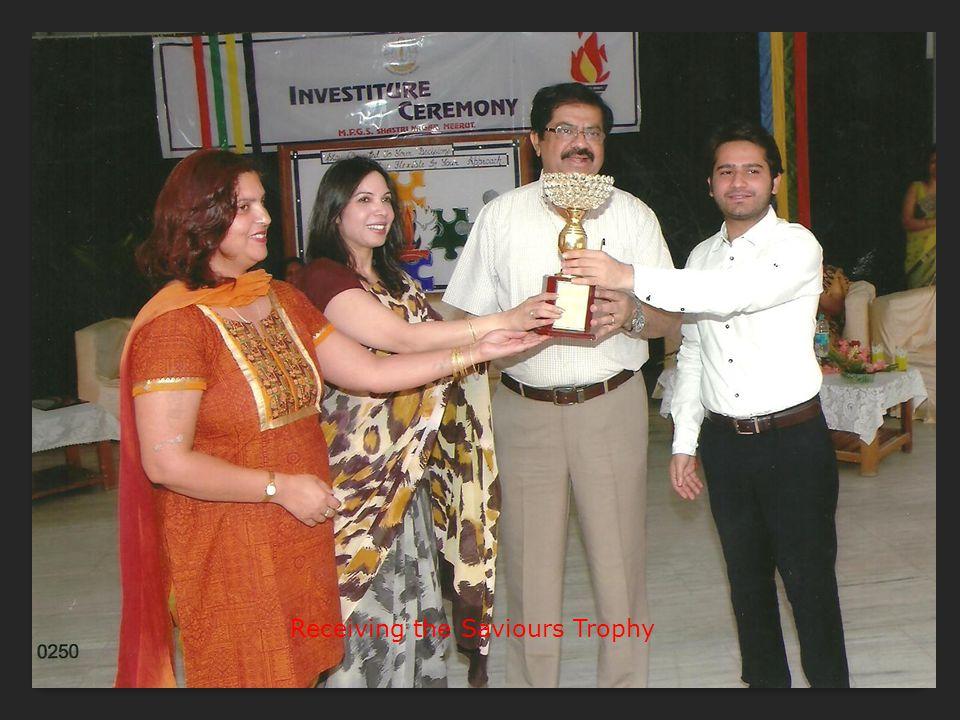 Receiving the Saviours Trophy