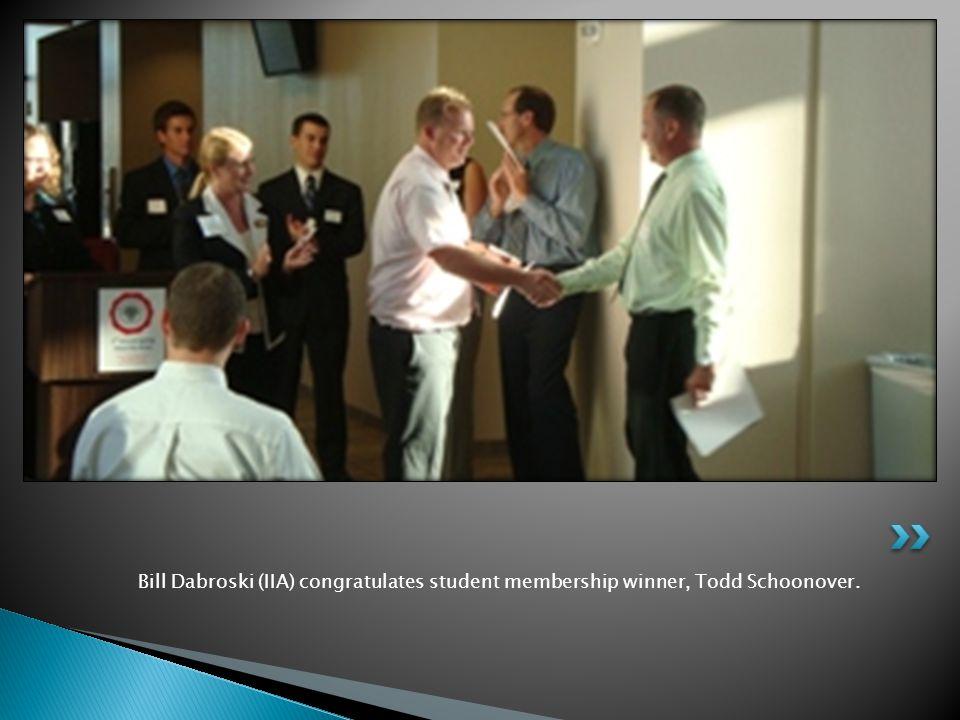 Bill Dabroski (IIA) congratulates student membership winner, Todd Schoonover.