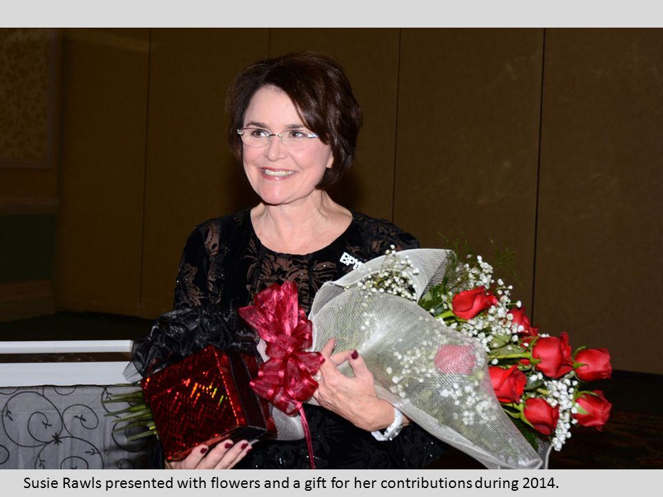 Susie Rawls presented with flowers and a gift for her contributions during 2014.