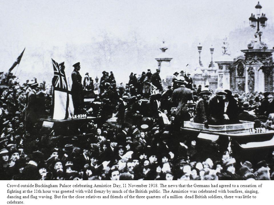 Crowd outside Buckingham Palace celebrating Armistice Day, 11 November 1918.