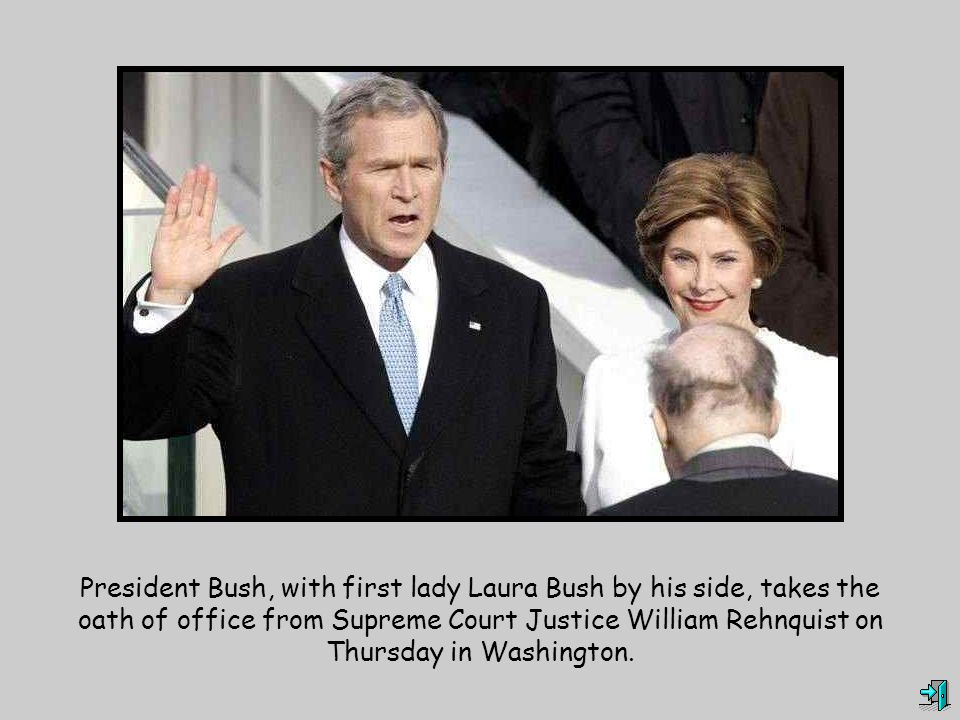 President Bush, with first lady Laura Bush by his side, takes the oath of office from Supreme Court Justice William Rehnquist on Thursday in Washington.