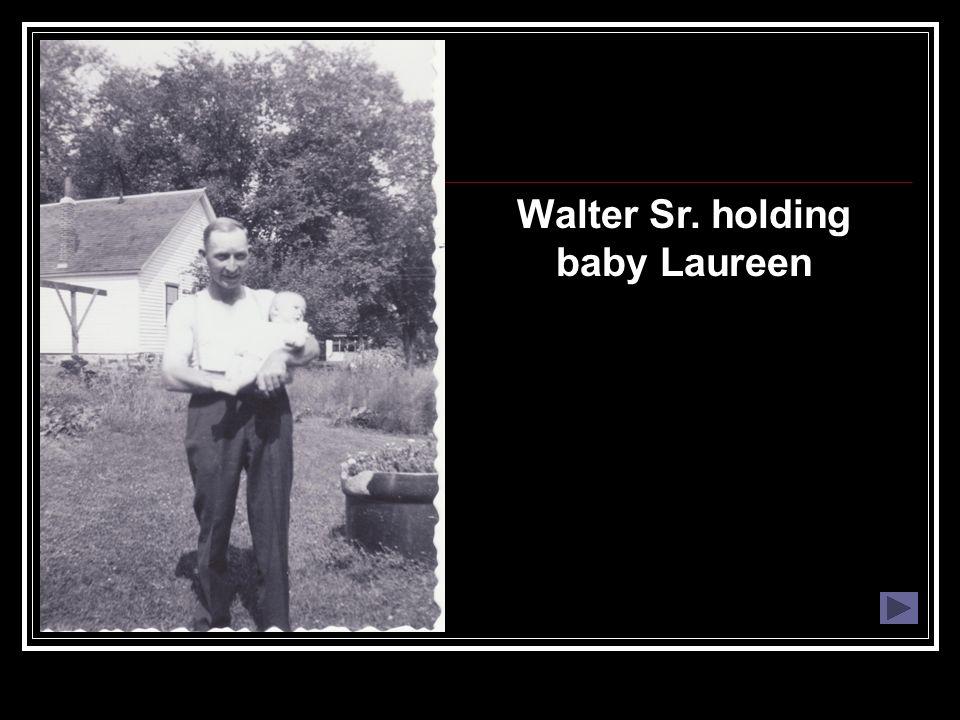 Walter Sr. holding baby Laureen