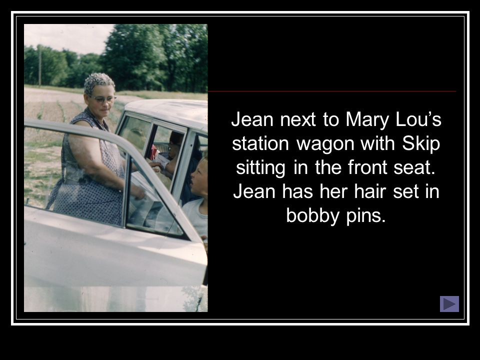 Jean next to Mary Lou's station wagon with Skip sitting in the front seat.