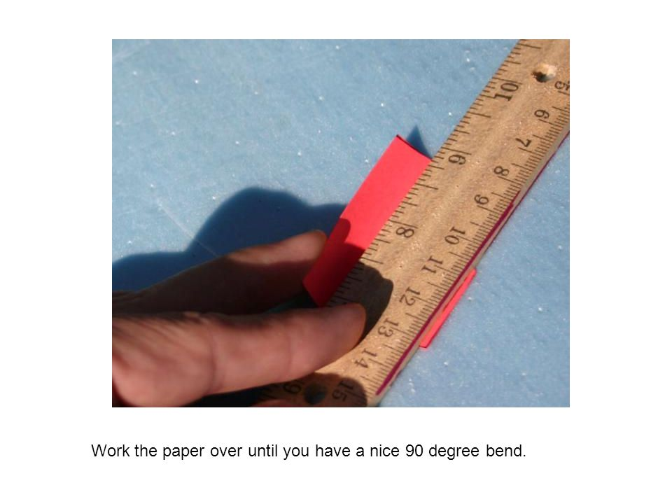 Work the paper over until you have a nice 90 degree bend.