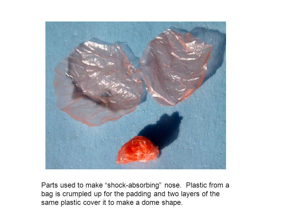 "Parts used to make ""shock-absorbing"" nose. Plastic from a bag is crumpled up for the padding and two layers of the same plastic cover it to make a dom"