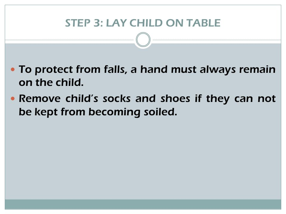 STEP 4: CLEAN CHILD'S DIAPER AREA Unfasten diaper and fold inward, leaving soiled diaper under the child.