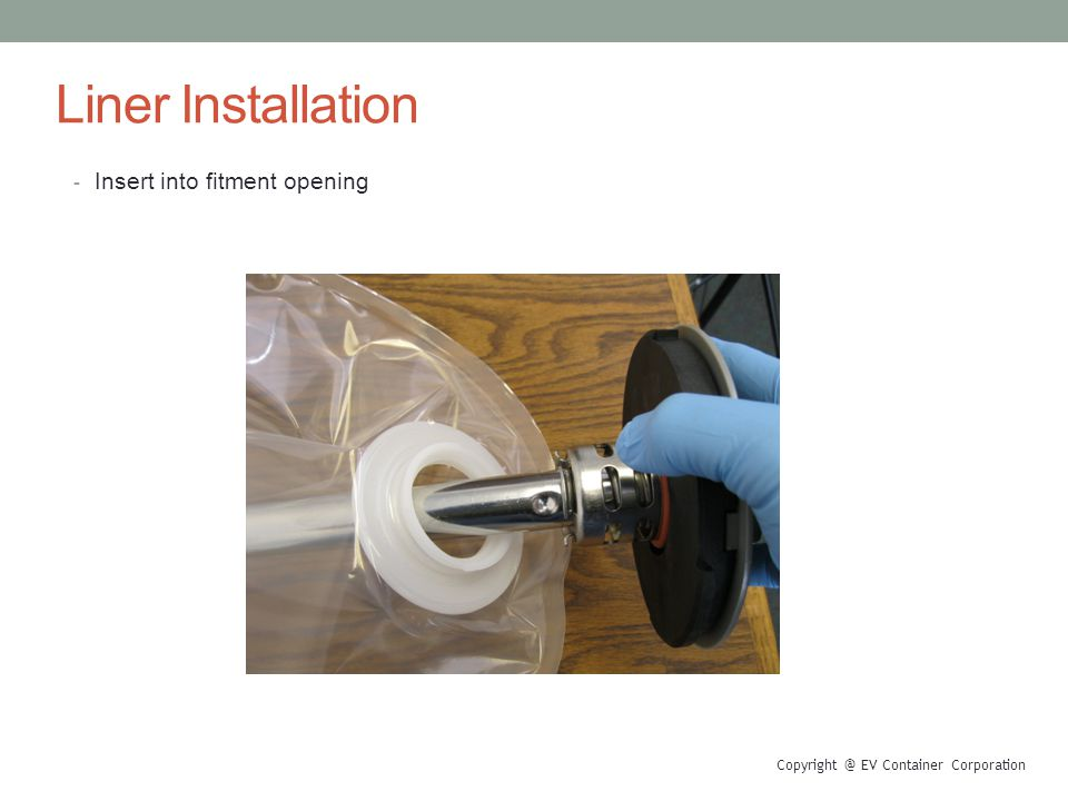 Liner Installation - Insert into fitment opening EV Container Corporation