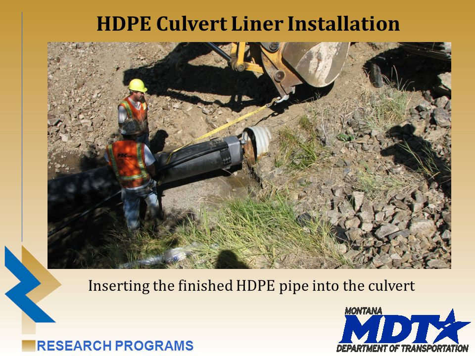 RESEARCH PROGRAMS Inserting the finished HDPE pipe into the culvert HDPE Culvert Liner Installation