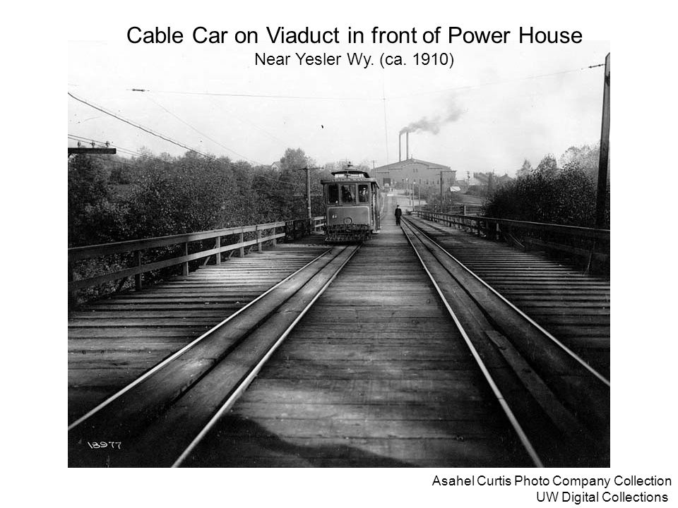 Asahel Curtis Photo Company Collection UW Digital Collections Cable Car on Viaduct in front of Power House Near Yesler Wy. (ca. 1910)