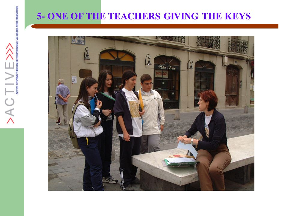 5- ONE OF THE TEACHERS GIVING THE KEYS