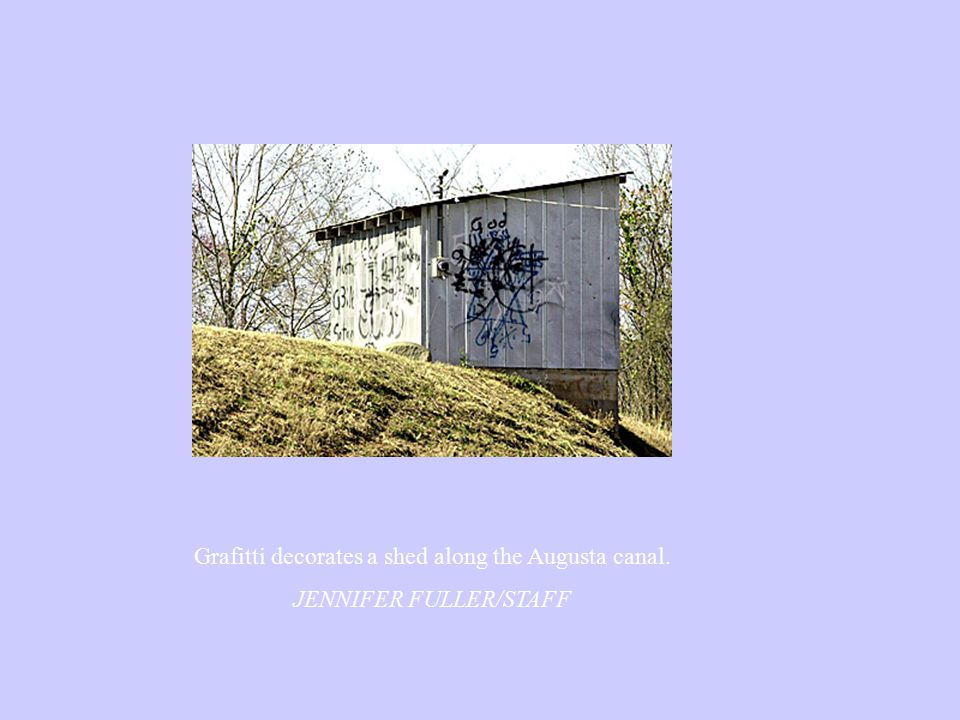 Grafitti decorates a shed along the Augusta canal. JENNIFER FULLER/STAFF