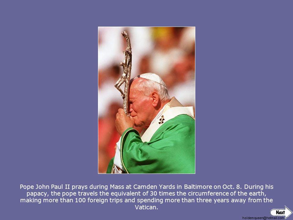 holdemqueen@hotmail.com Pope John Paul II prays during Mass at Camden Yards in Baltimore on Oct.