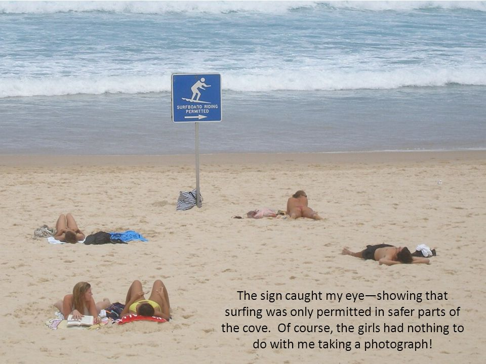 The sign caught my eye—showing that surfing was only permitted in safer parts of the cove.