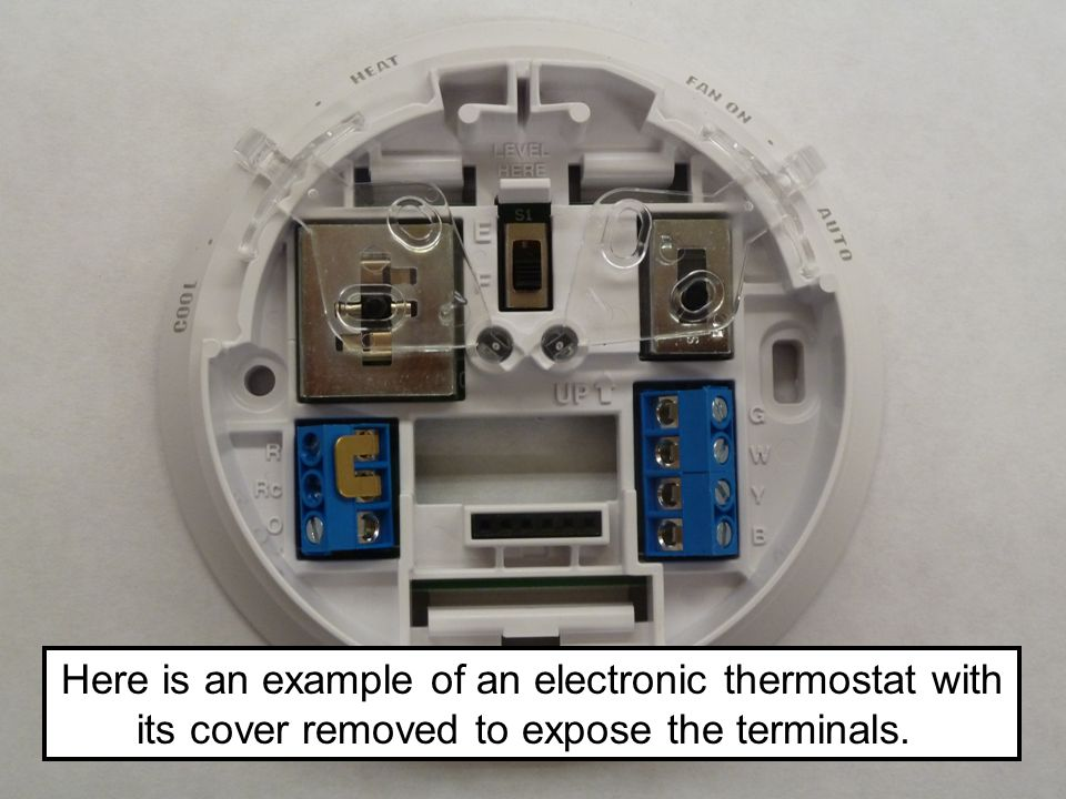 Here is an example of an electronic thermostat with its cover removed to expose the terminals.