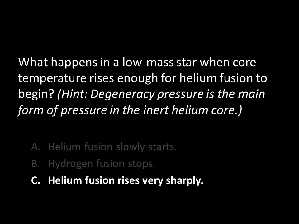 What happens in a low-mass star when core temperature rises enough for helium fusion to begin.