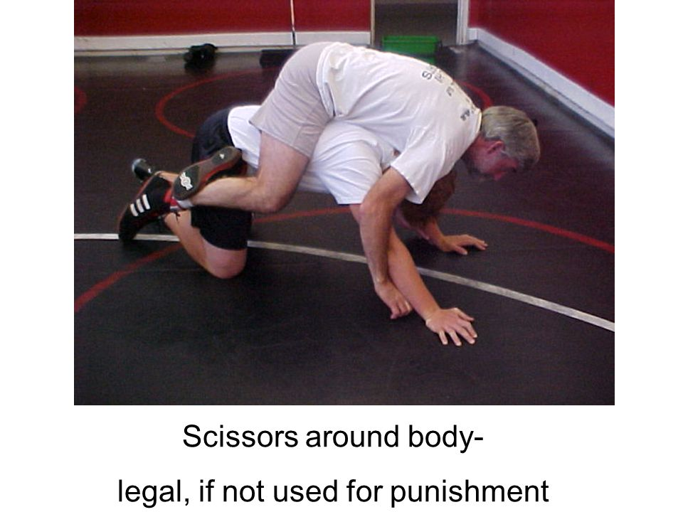 Scissors around body- legal, if not used for punishment