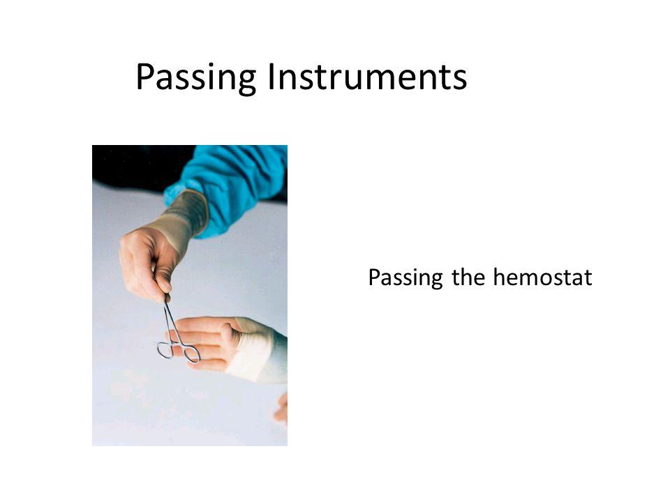 Passing Instruments Passing the hemostat