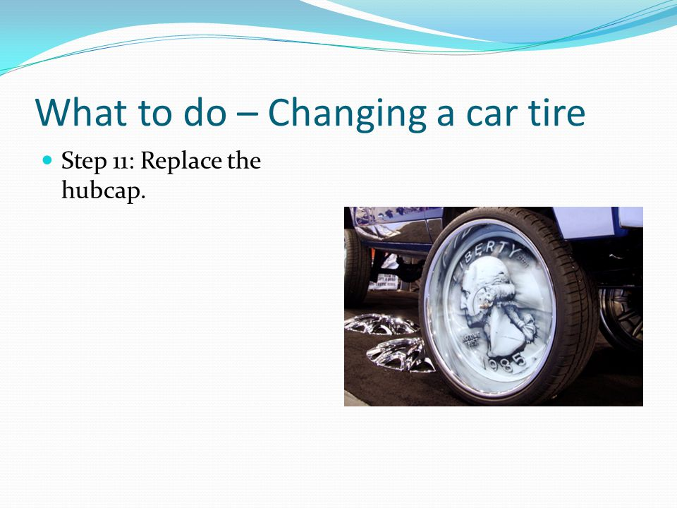 What to do – Changing a car tire Step 11: Replace the hubcap.