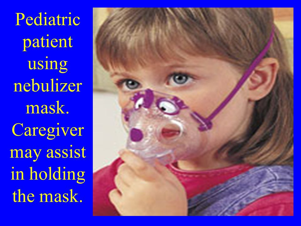 Pediatric patient using nebulizer mask. Caregiver may assist in holding the mask.