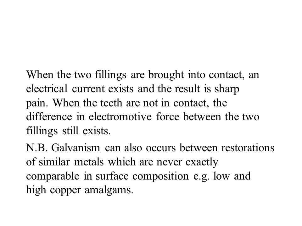 When the two fillings are brought into contact, an electrical current exists and the result is sharp pain. When the teeth are not in contact, the diff