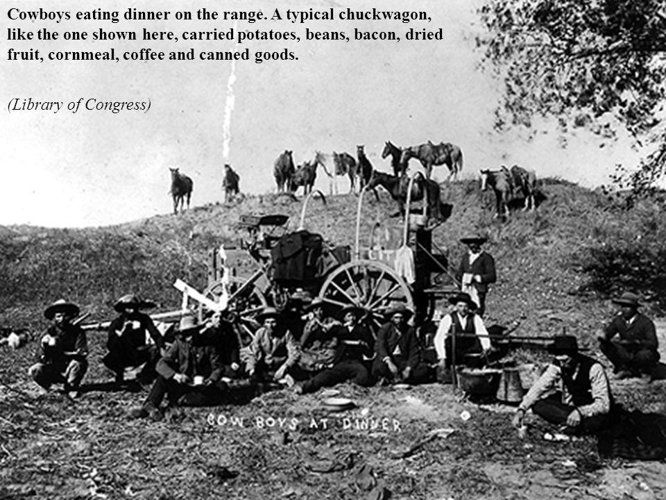 Cowboys eating dinner on the range.