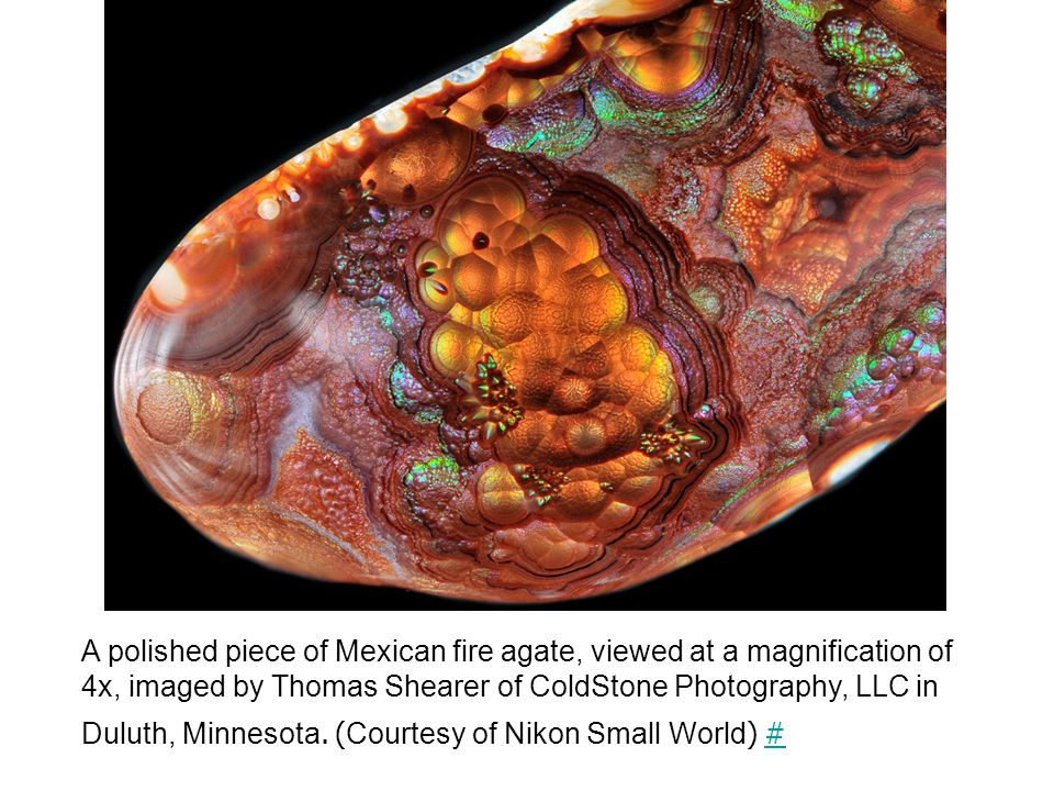 A polished piece of Mexican fire agate, viewed at a magnification of 4x, imaged by Thomas Shearer of ColdStone Photography, LLC in Duluth, Minnesota.