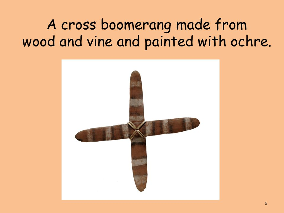 A cross boomerang made from wood and vine and painted with ochre. 6