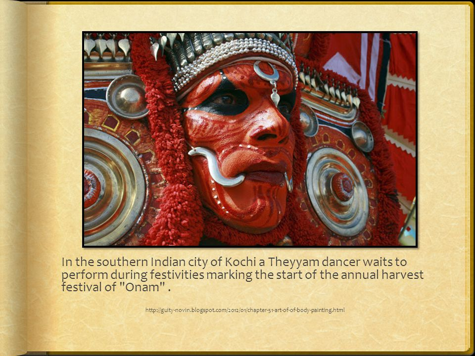 In the southern Indian city of Kochi a Theyyam dancer waits to perform during festivities marking the start of the annual harvest festival of Onam .