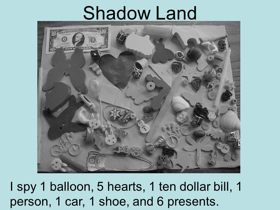 Shadow Land I spy 1 balloon, 5 hearts, 1 ten dollar bill, 1 person, 1 car, 1 shoe, and 6 presents.