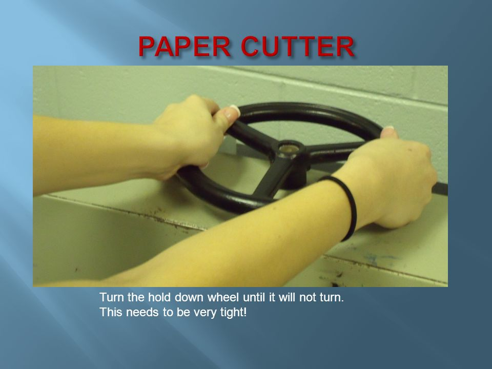 Pull the RED Safety knob With your other hand reach and grab the cutter handle