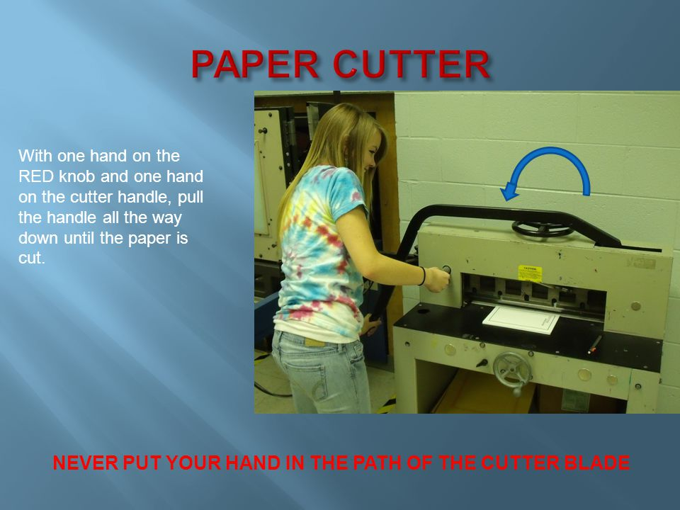 Lift the cutter handle. Release the pressure on the Hold Down Wheel.