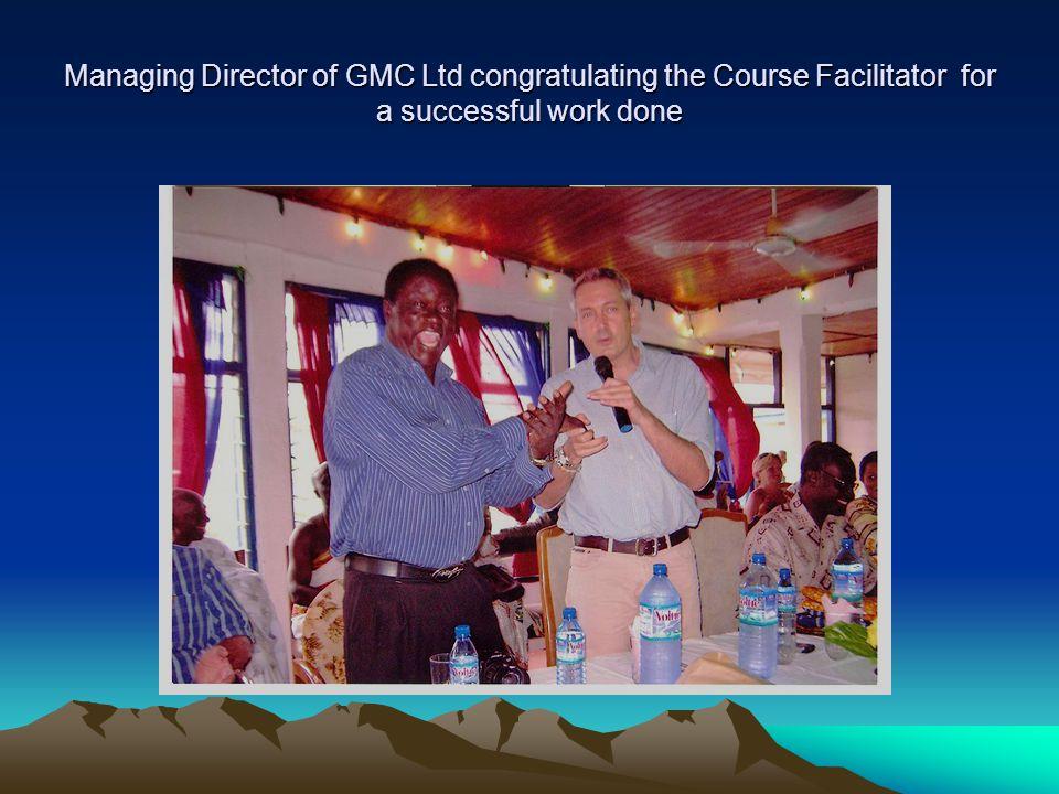 Managing Director of GMC Ltd congratulating the Course Facilitator for a successful work done