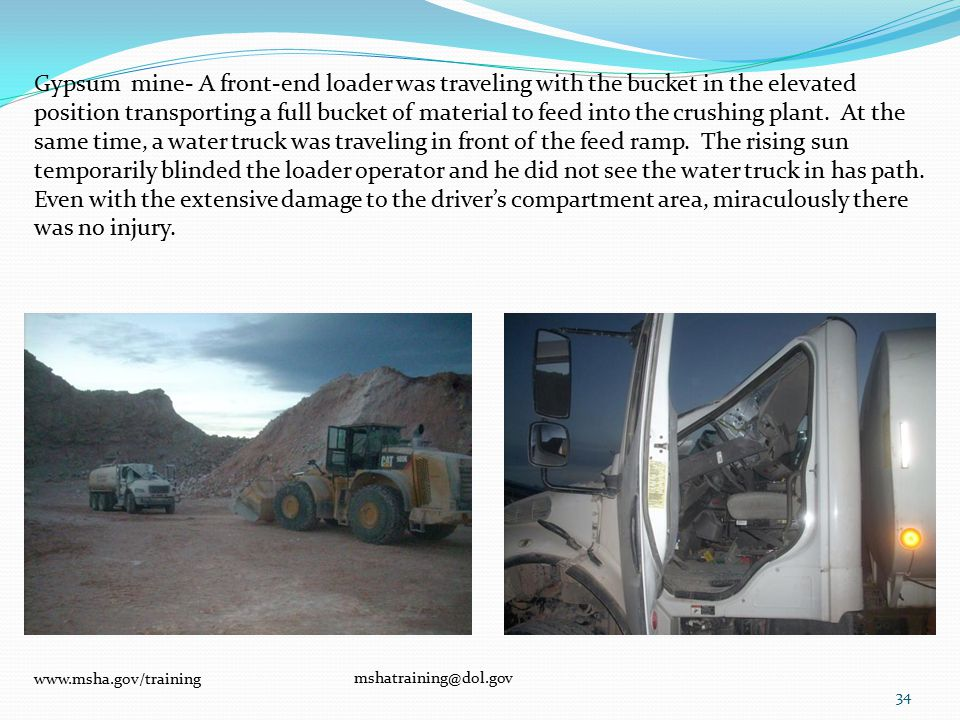 Gypsum mine- A front-end loader was traveling with the bucket in the elevated position transporting a full bucket of material to feed into the crushing plant.