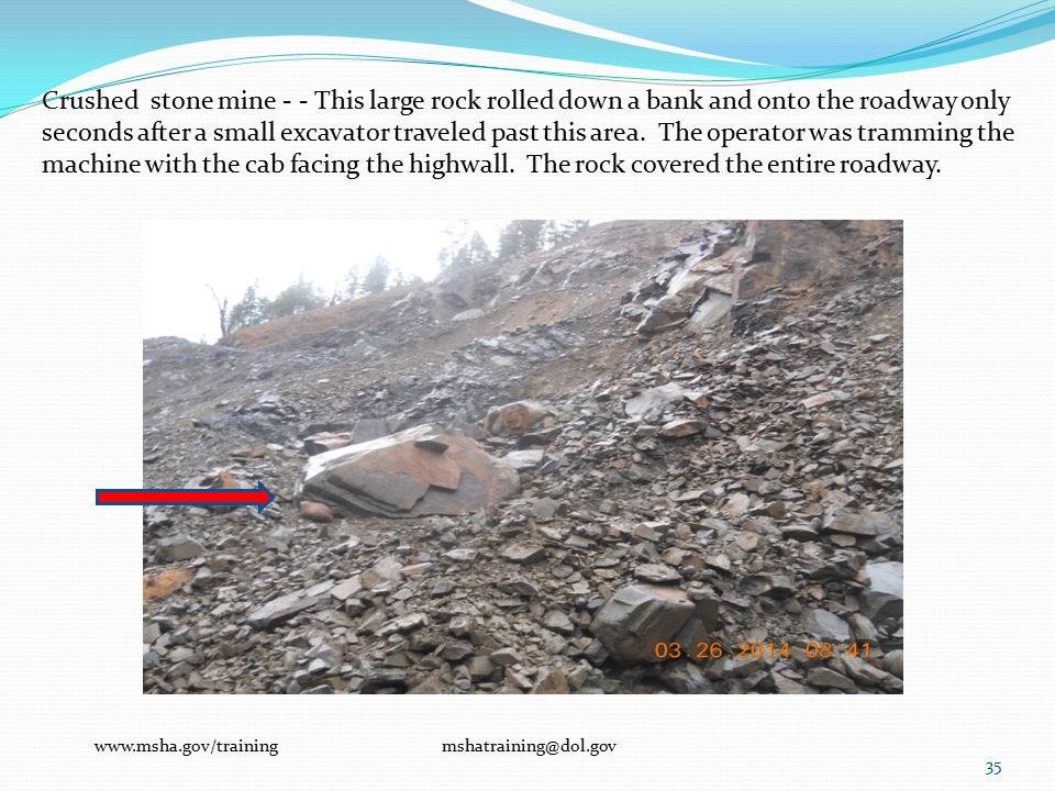 Crushed stone mine - - This large rock rolled down a bank and onto the roadway only seconds after a small excavator traveled past this area.