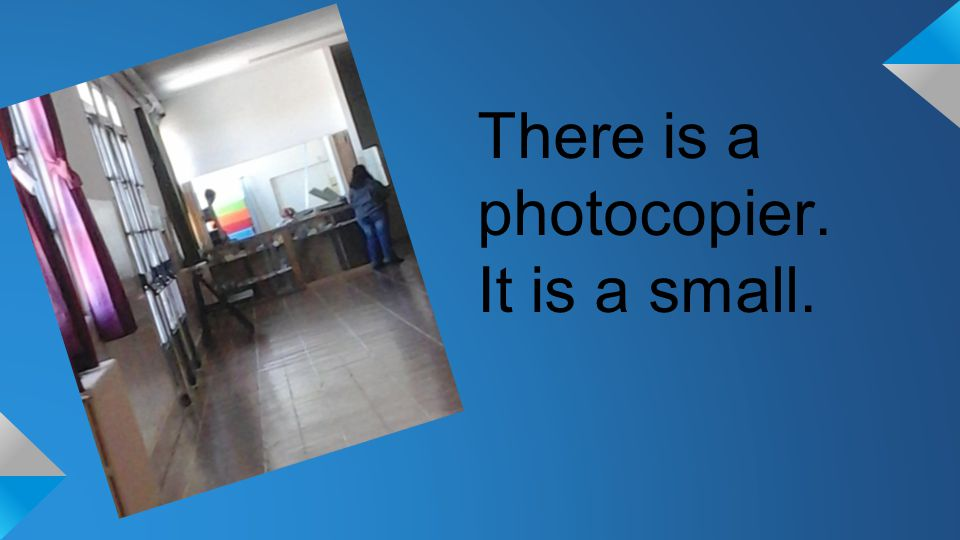 There is a photocopier. It is a small.