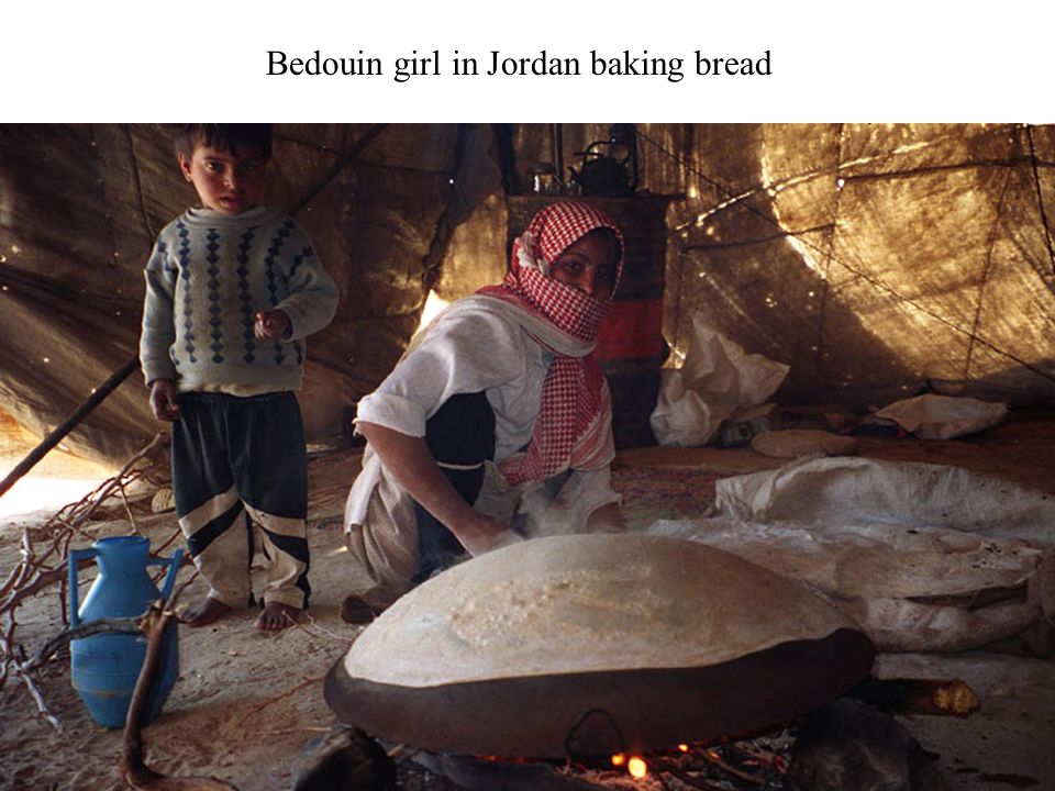 Bedouin girl in Jordan baking bread